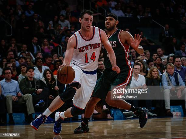 Jason Smith of the New York Knicks drives the ball against Jared Dudley of the Milwaukee Bucks at Madison Square Garden on April 10 2015 in New York...