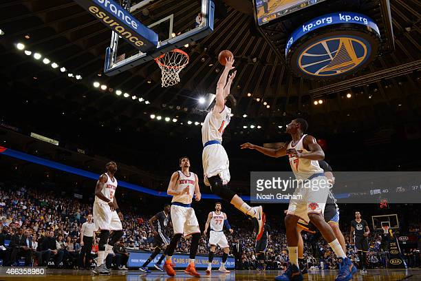 Jason Smith of the New York Knicks drives to the basket against the Golden State Warriors on March 14 2015 at Oracle Arena in Oakland California NOTE...