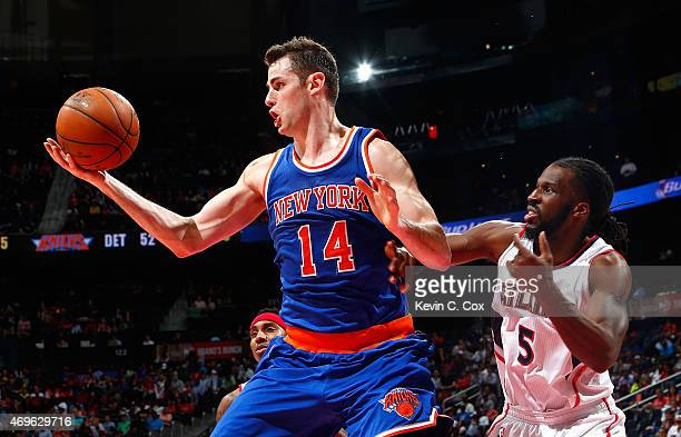 Jason Smith of the New York Knicks grabs a rebound against DeMarre Carroll of the Atlanta Hawks at Philips Arena on April 13 2015 in Atlanta Georgia...