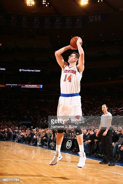 Jason Smith of the New York Knicks shoots the ball against the Phoenix Suns during the game on December 20 2014 at Madison Square Garden in New York...