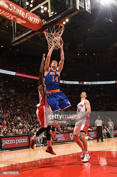 Jason Smith of the New York Knicks shoots the ball against the Toronto Raptors during the game on December 21 2014 at the Air Canada Centre in...