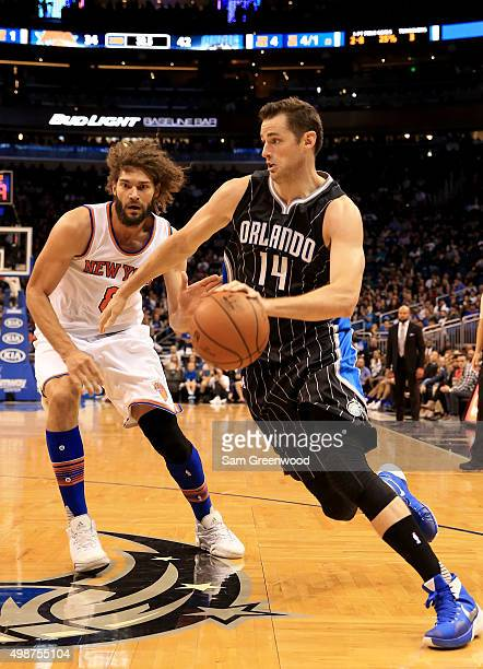 Jason Smith of the Orlando Magic drives against Robin Lopez of the New York Knicks during the game at Amway Center on November 25 2015 in Orlando...