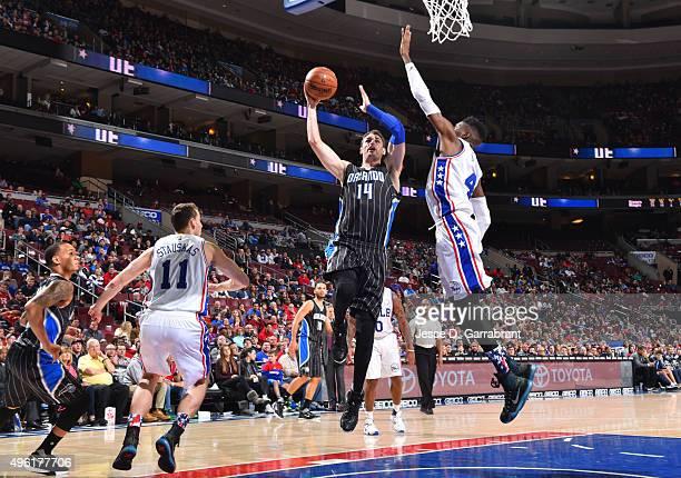 Jason Smith of the Orlando Magic goes up for the layup against the Philadelphia 76ers at Wells Fargo Center on November 7 2015 in Philadelphia...