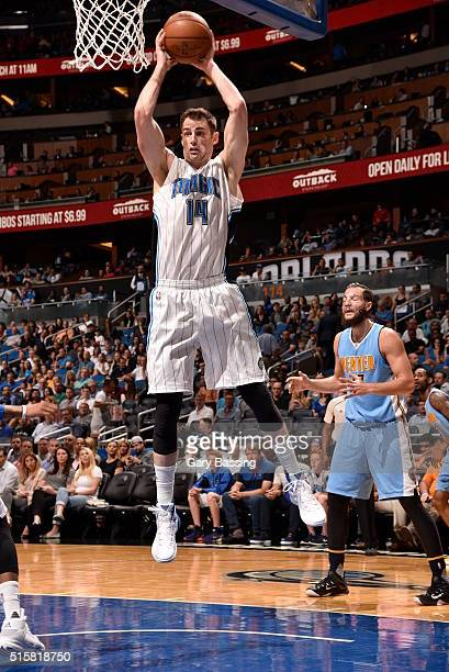 Jason Smith of the Orlando Magic grabs the rebound against the Denver Nuggets on March 15 2016 at the Amway Center in Orlando Florida NOTE TO USER...