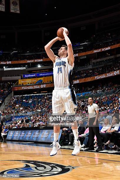 Jason Smith of the Orlando Magic shoots against the Miami Heat during a preseason game on October 13 2015 at Amway Center in Orlando Florida NOTE TO...