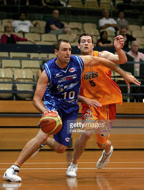 Jason Smith of the Spirit drives to the basket during the round eight NBL match between the Sydney Spirit and the Melbourne Tigers at the Sydney...