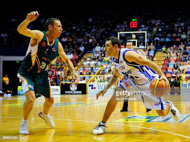 Jason Smith of the Spirit looks to get past John Rilllie of the Crocs during the round 12 NBL match between the Townsville Crocodiles and the Sydney...
