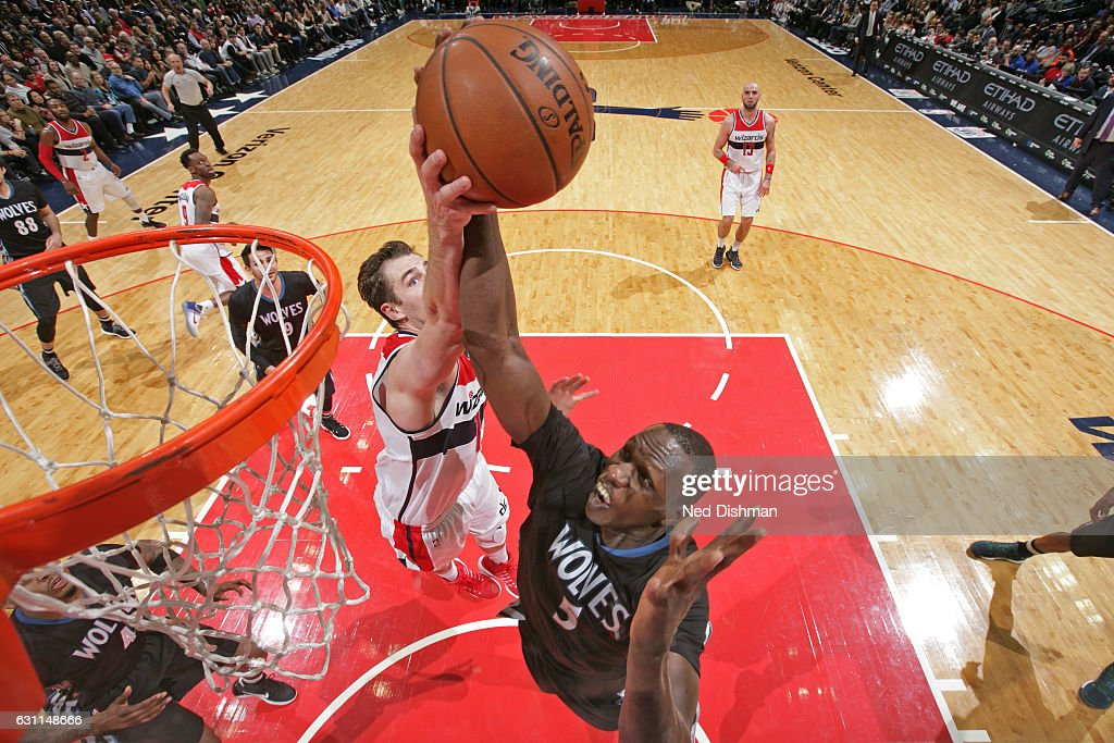 Jason Smith #14 of the Washington Wizards goes up for a rebound against Gorgui Dieng #5 of the Minnesota Timberwolveson on January 6, 2017 at Verizon Center in Washington, DC.