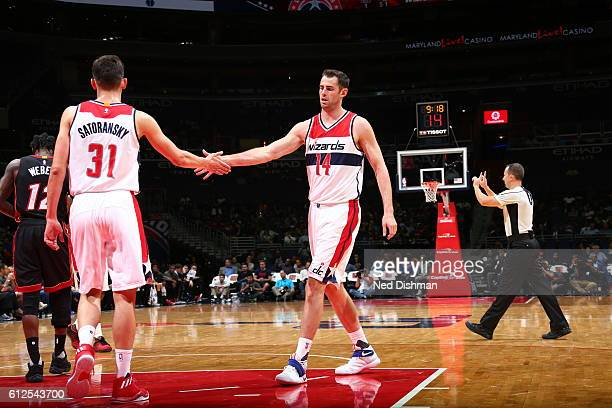 Jason Smith of the Washington Wizards high fives Tomas Satoransky during the game against the Miami Heat during a preseason game on October 4 2016 at...