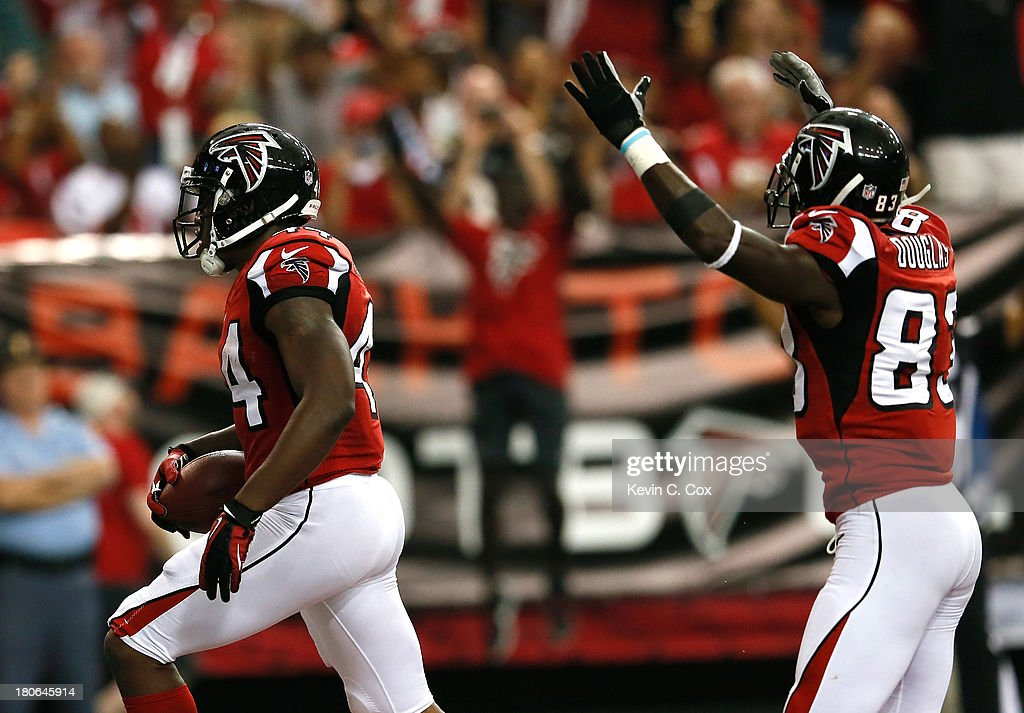 Jason Snelling #44 and Harry Douglas #83 of the Atlanta Falcons reacts after Snelling scored a touchdown against the St. Louis Rams at Georgia Dome on September 15, 2013 in Atlanta, Georgia.