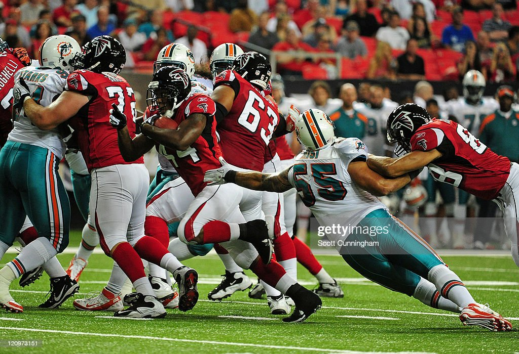 Jason Snelling #44 of the Atlanta Falcons carries the ball against the Miami Dolphins during a preseason game at the Georgia Dome on August 12, 2011 in Atlanta, Georgia.