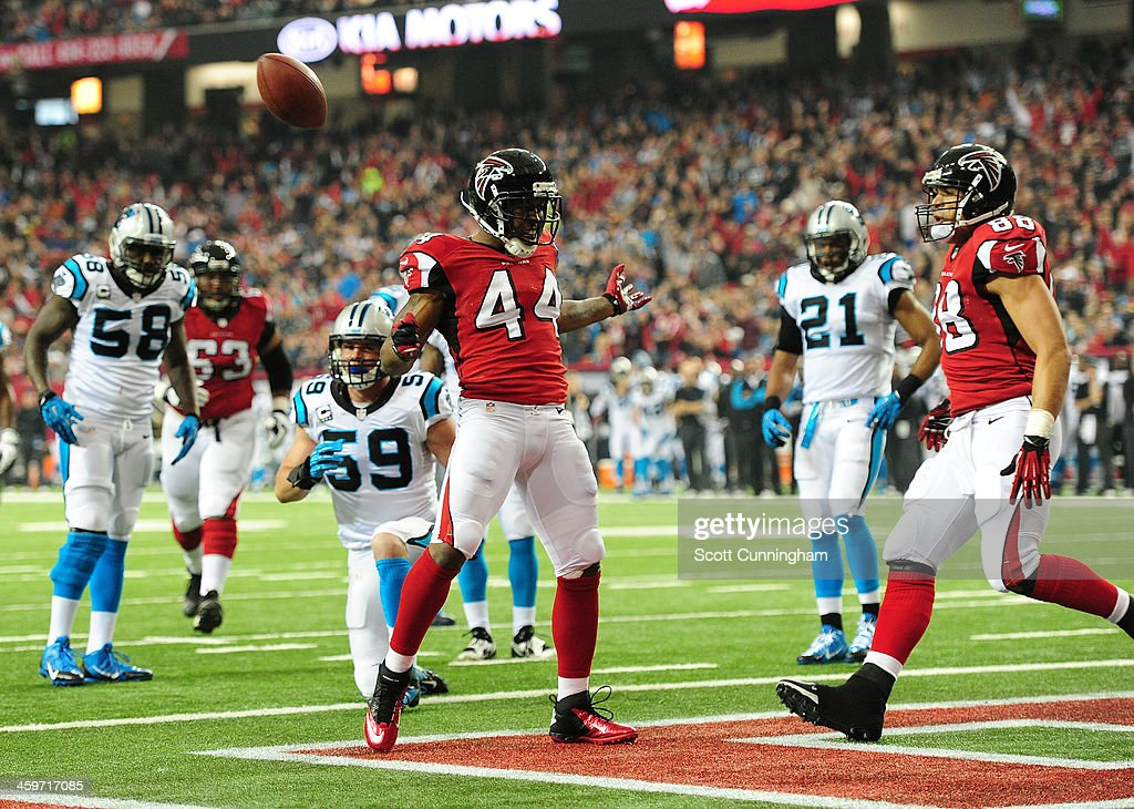 Jason Snelling of the Atlanta Falcons celebrates after scoring a first quarter touchdown against the Carolina Panthers at the Georgia Dome on...