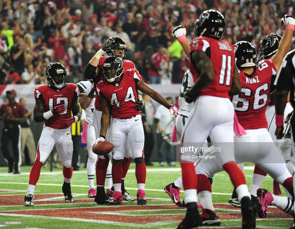 Jason Snelling of the Atlanta Falcons is congratulated by teammates after scoring a touchdown against the New York Jets at the Georgia Dome on...