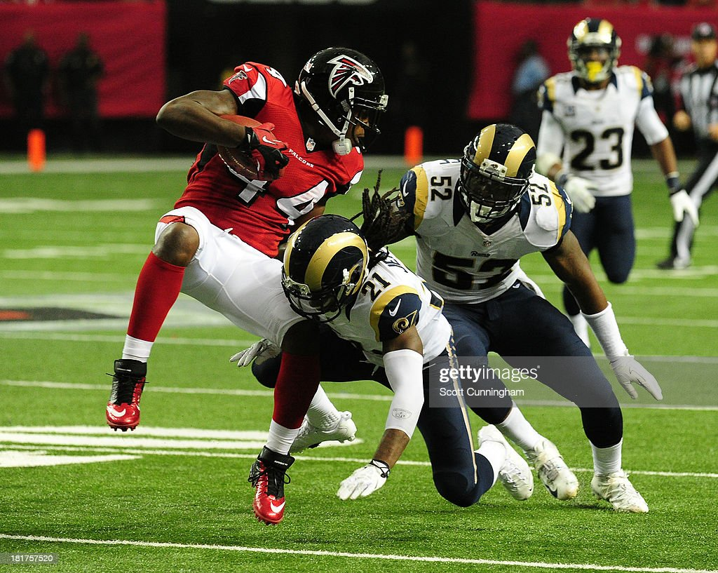 Jason Snelling of the Atlanta Falcons is tackled by Janoris Jenkins and Alec Ogletree of the St Louis Rams at the Georgia Dome on September 15 2013...