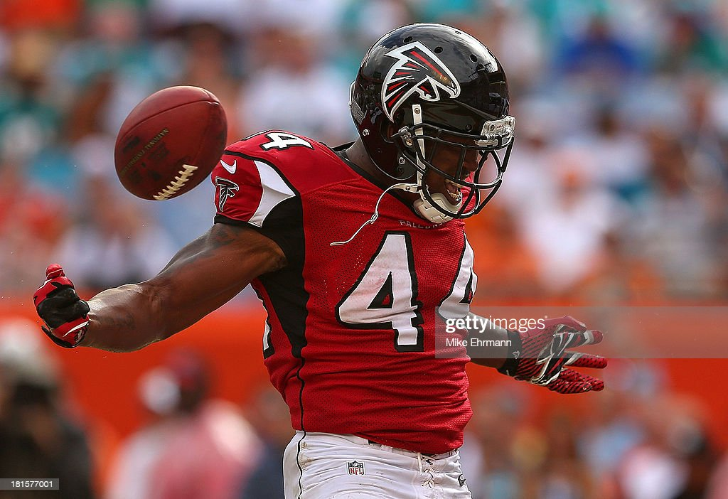 Jason Snelling of the Atlanta Falcons reacts to scoring a touchdown during a game against the Miami Dolphins at Sun Life Stadium on September 22 2013...