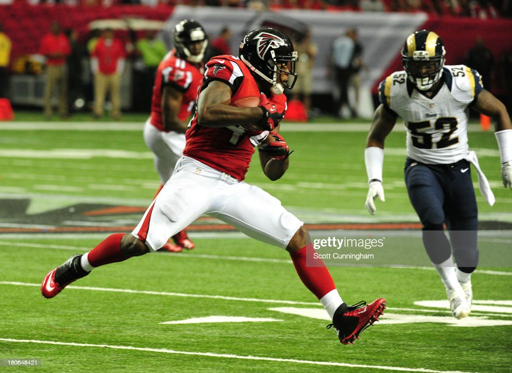 <a gi-track='captionPersonalityLinkClicked' href=/galleries/search?phrase=Jason+Snelling&family=editorial&specificpeople=2143404 ng-click='$event.stopPropagation()'>Jason Snelling</a> #44 of the Atlanta Falcons runs with a catch against the St. Louis Rams at the Georgia Dome on September 15, 2013 in Atlanta, Georgia.