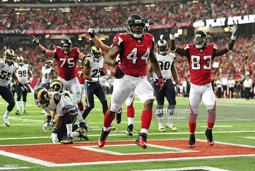 Jason Snelling of the Atlanta Falcons scores a 4th quarter touchdown against the St Louis Rams at the Georgia Dome on September 15 2013 in Atlanta...