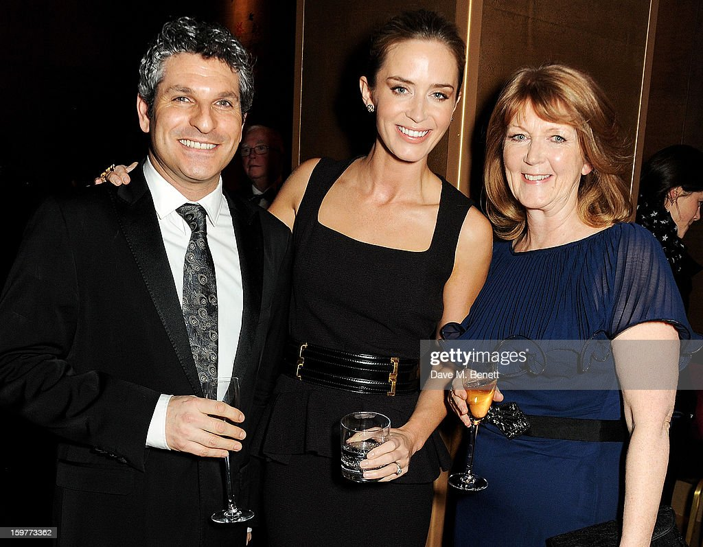 Jason Solomons, Emily Blunt and mother Joanna Blunt attend a champagne reception at the London Critics Circle Film Awards at the May Fair Hotel on January 20, 2013 in London, England.
