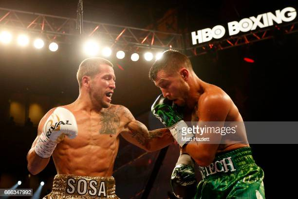 Jason Sosa exchanges punches with Vasyl Lomachenko of Ukraine during their WBO Super Featherweight World Championship bout at The Theater at MGM...