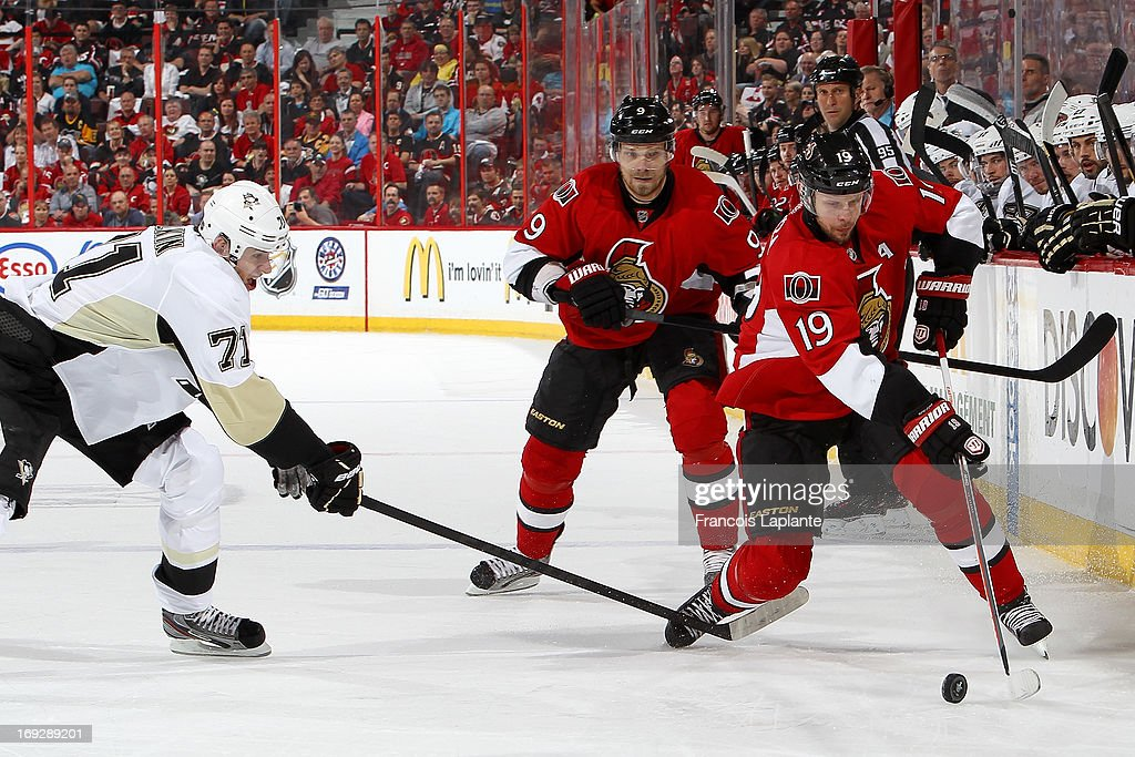 Jason Spezza #19 and Milan Michalek #9 of the Ottawa Senators skate with the puck against Evgeni Malkin #71 of the Pittsburgh Penguins in Game Four of the Eastern Conference Semifinals during the 2013 NHL Stanley Cup Playoffs at Scotiabank Place on May 22, 2013 in Ottawa, Ontario, Canada.