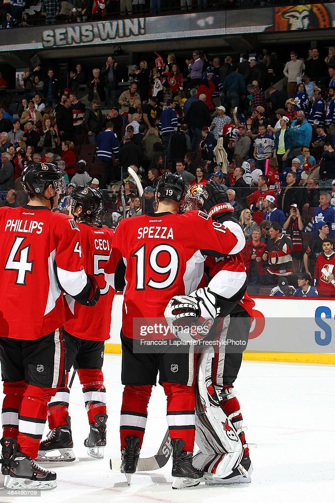 Jason Spezza #19, Craig Anderson #41 and Chris Phillips #4 of the Ottawa Senators celebrate their victory against the Toronto Maple Leafs on April 12, 2014 at Canadian Tire Centre in Ottawa, Ontario, Canada.