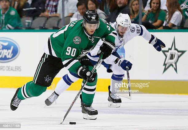 Jason Spezza of the Dallas Stars controls the pucks against Nikita Kucherov of the Tampa Bay Lightning in the third period of a preseason game at...