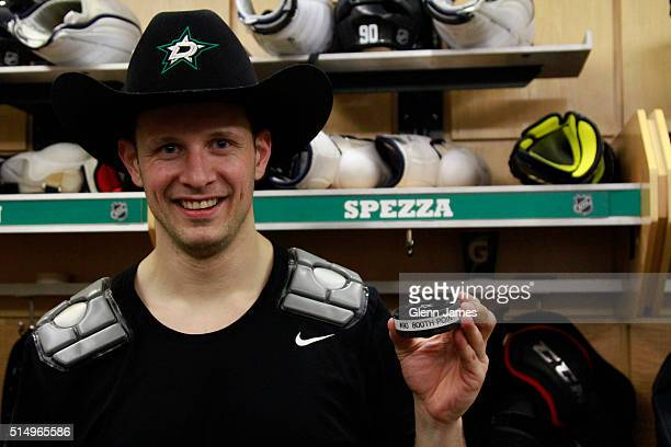 Jason Spezza of the Dallas Stars poses with the puck after scoring his 800th career point against the Chicago Blackhawks at the American Airlines...