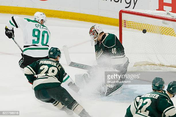 Jason Spezza of the Dallas Stars scores a goal against Jason Pominville and goalie Devan Dubnyk of the Minnesota Wild in Game Four of the Western...