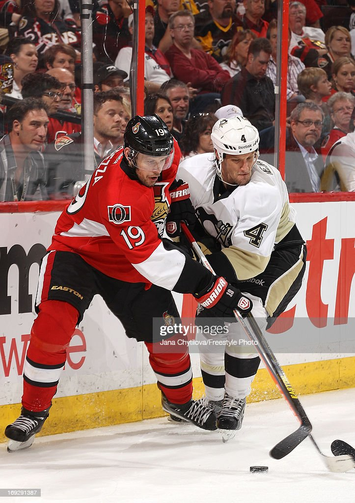 Jason Spezza #19 of the Ottawa Senators battles against Mark Eaton #4 of the Pittsburgh Penguins for the loose puck in Game Four of the Eastern Conference Semifinals during the 2013 NHL Stanley Cup Playoffs, at Scotiabank Place, on May 22, 2013 in Ottawa, Ontario, Canada.