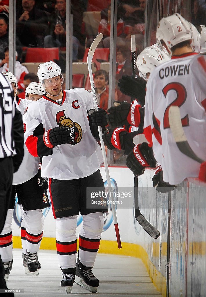 <a gi-track='captionPersonalityLinkClicked' href=/galleries/search?phrase=Jason+Spezza&family=editorial&specificpeople=202023 ng-click='$event.stopPropagation()'>Jason Spezza</a> #19 of the Ottawa Senators celebrates his second period goal with teammates while playing the Detroit Red Wings at Joe Louis Arena on October 23, 2013 in Detroit, Michigan.