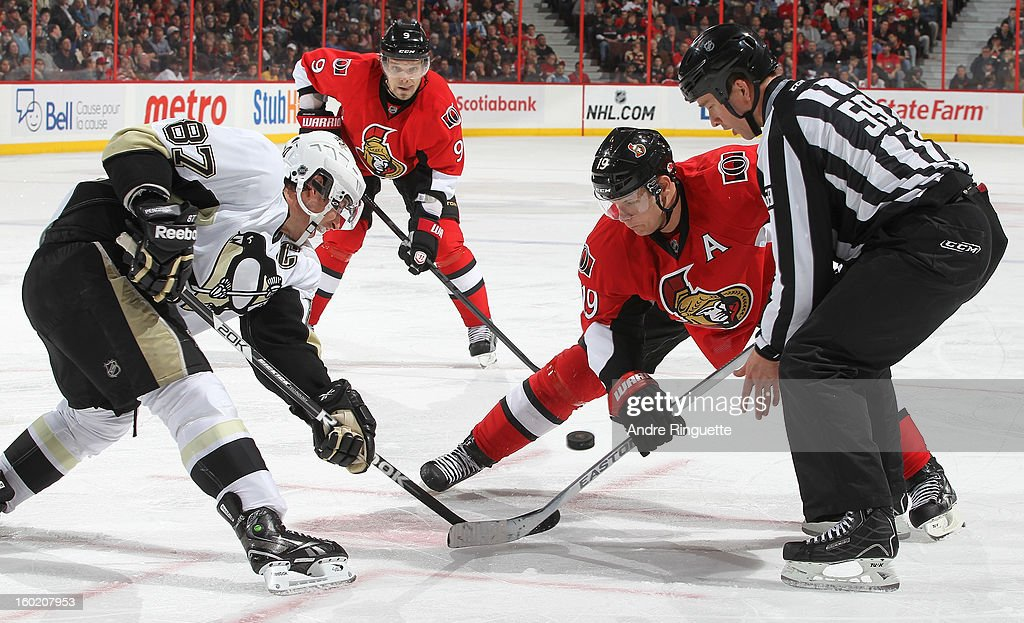 <a gi-track='captionPersonalityLinkClicked' href=/galleries/search?phrase=Jason+Spezza&family=editorial&specificpeople=202023 ng-click='$event.stopPropagation()'>Jason Spezza</a> #19 of the Ottawa Senators faces off against <a gi-track='captionPersonalityLinkClicked' href=/galleries/search?phrase=Sidney+Crosby&family=editorial&specificpeople=212781 ng-click='$event.stopPropagation()'>Sidney Crosby</a> #87 of the Pittsburgh Penguins with teammate <a gi-track='captionPersonalityLinkClicked' href=/galleries/search?phrase=Milan+Michalek&family=editorial&specificpeople=544987 ng-click='$event.stopPropagation()'>Milan Michalek</a> #9 ready for the play on January 27, 2013 at Scotiabank Place in Ottawa, Ontario, Canada.