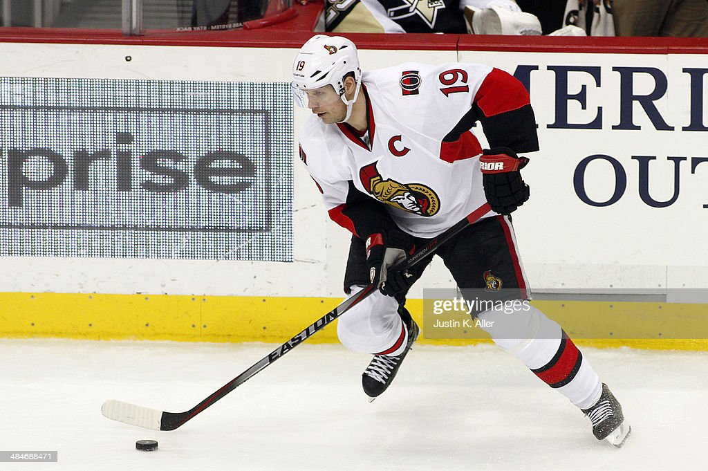 Jason Spezza #19 of the Ottawa Senators handles the puck against the Pittsburgh Penguins during the game at Consol Energy Center on April 13, 2014 in Pittsburgh, Pennsylvania. The Senators defeated the Penguins 3-2 in a shootout.