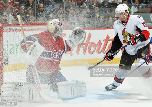 Jason Spezza of the Ottawa Senators looks for a loose puck in front of goalie Carey Price of the Montreal Canadiens during the NHL game on December 7...