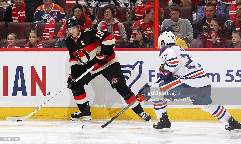 <a gi-track='captionPersonalityLinkClicked' href=/galleries/search?phrase=Jason+Spezza&family=editorial&specificpeople=202023 ng-click='$event.stopPropagation()'>Jason Spezza</a> #19 of the Ottawa Senators looks to pass the puck against <a gi-track='captionPersonalityLinkClicked' href=/galleries/search?phrase=Boyd+Gordon&family=editorial&specificpeople=209395 ng-click='$event.stopPropagation()'>Boyd Gordon</a> #27 of the Edmonton Oilers during an NHL game at Canadian Tire Centre on October 19, 2012 in Ottawa, Ontario, Canada.
