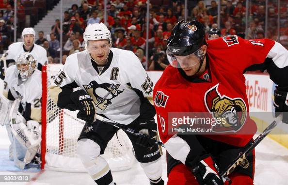 Jason Spezza of the Ottawa Senators plays the puck as Sergei Gonchar of the Pittsburgh Penguins defends in Game 4 of the Eastern Conference...