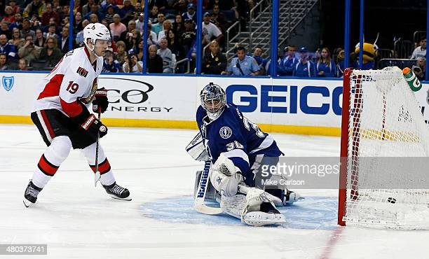 Jason Spezza of the Ottawa Senators scores in a shoot out past Ben Bishop of the Tampa Bay Lightning at the Tampa Bay Times Forum on March 24 2014 in...