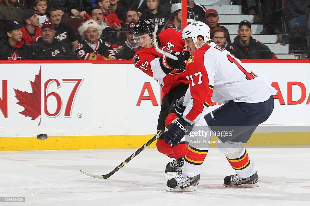 <a gi-track='captionPersonalityLinkClicked' href=/galleries/search?phrase=Jason+Spezza&family=editorial&specificpeople=202023 ng-click='$event.stopPropagation()'>Jason Spezza</a> #19 of the Ottawa Senators shoots the puck against <a gi-track='captionPersonalityLinkClicked' href=/galleries/search?phrase=Filip+Kuba&family=editorial&specificpeople=209425 ng-click='$event.stopPropagation()'>Filip Kuba</a> #17 of the Florida Panthers on January 21, 2013 at Scotiabank Place in Ottawa, Ontario, Canada.