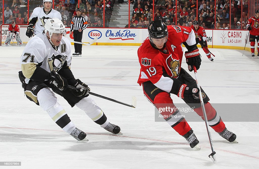 Jason Spezza #19 of the Ottawa Senators stickhandles the puck against Evgeni Malkin #71 of the Pittsburgh Penguins on January 27, 2013 at Scotiabank Place in Ottawa, Ontario, Canada.