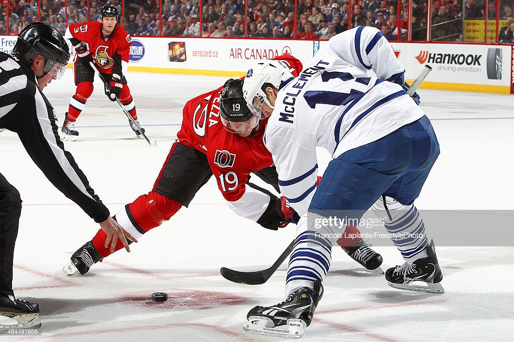Jason Spezza #19 of the Ottawa Senators takes a face-off against Jay McClement #11 of the Toronto Maple Leafs on April 12, 2014 at Canadian Tire Centre in Ottawa, Ontario, Canada.