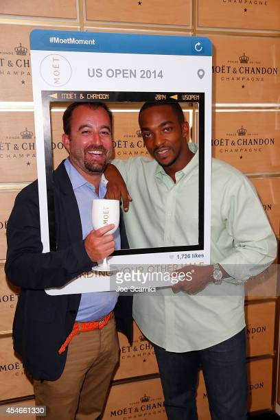 Jason Spire and Anthony Mackie attend the The Moet Chandon Suite at the 2014 US Open at USTA Billie Jean King National Tennis Center on September 4...