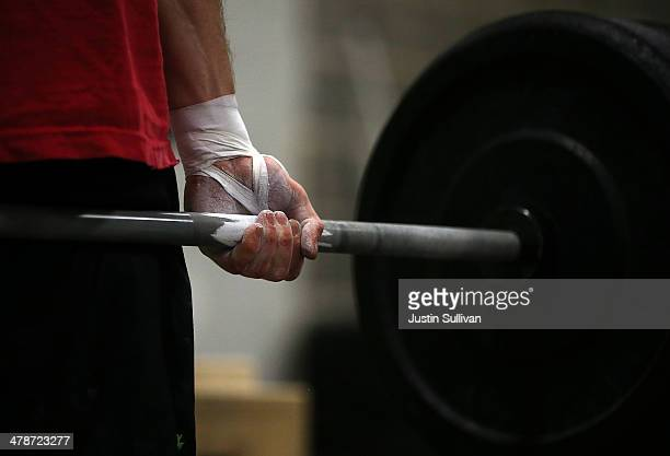 Jason Stanislawczyk does a deadlift during a CrossFit workout at Ross Valley CrossFit on March 13 2014 in San Anselmo California CrossFit a high...