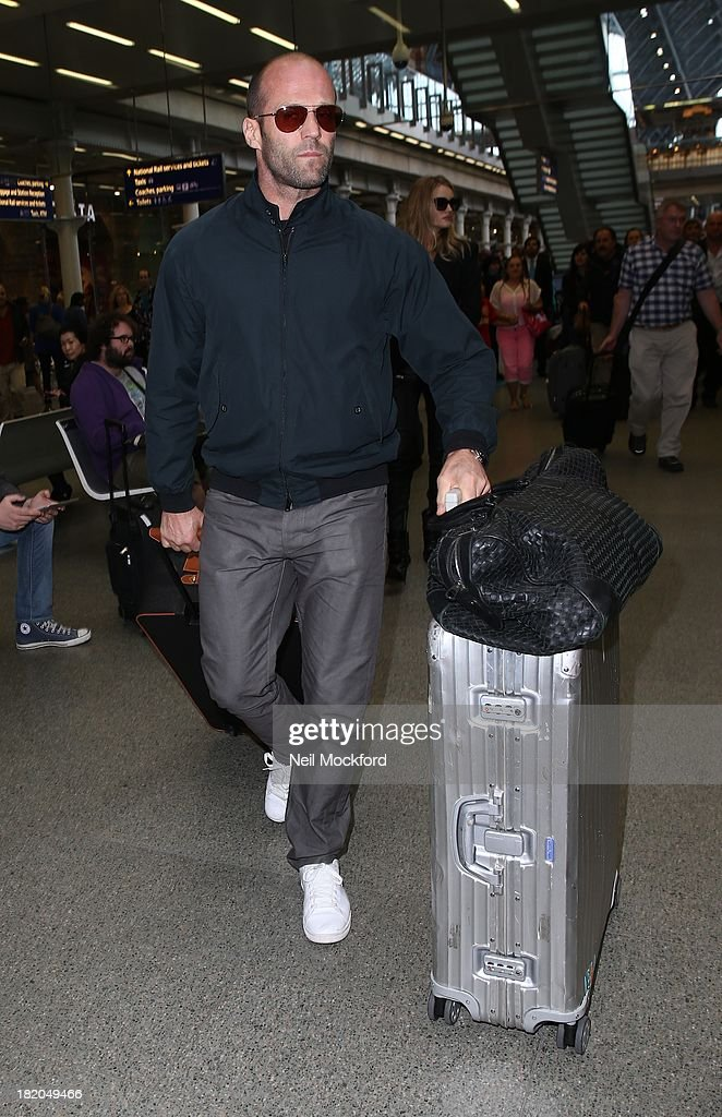 <a gi-track='captionPersonalityLinkClicked' href=/galleries/search?phrase=Jason+Statham&family=editorial&specificpeople=217567 ng-click='$event.stopPropagation()'>Jason Statham</a> arriving at Eurostar in London on September 27, 2013.