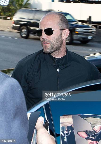 Jason Statham is seen arriving at Los Angeles International airport on November 26 2013 in Los Angeles California