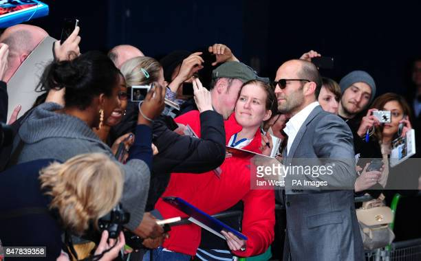 Jason Statham meets the public as he arrives at the premiere of his new film Safe at the Imax cinema in London