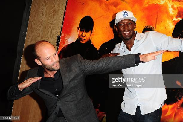 Jason Statham with Olympic Gold Medalist Usain Bolt arriving for the UK Premiere of The Expendables 2 at the Empire Cinema Leicester Square London