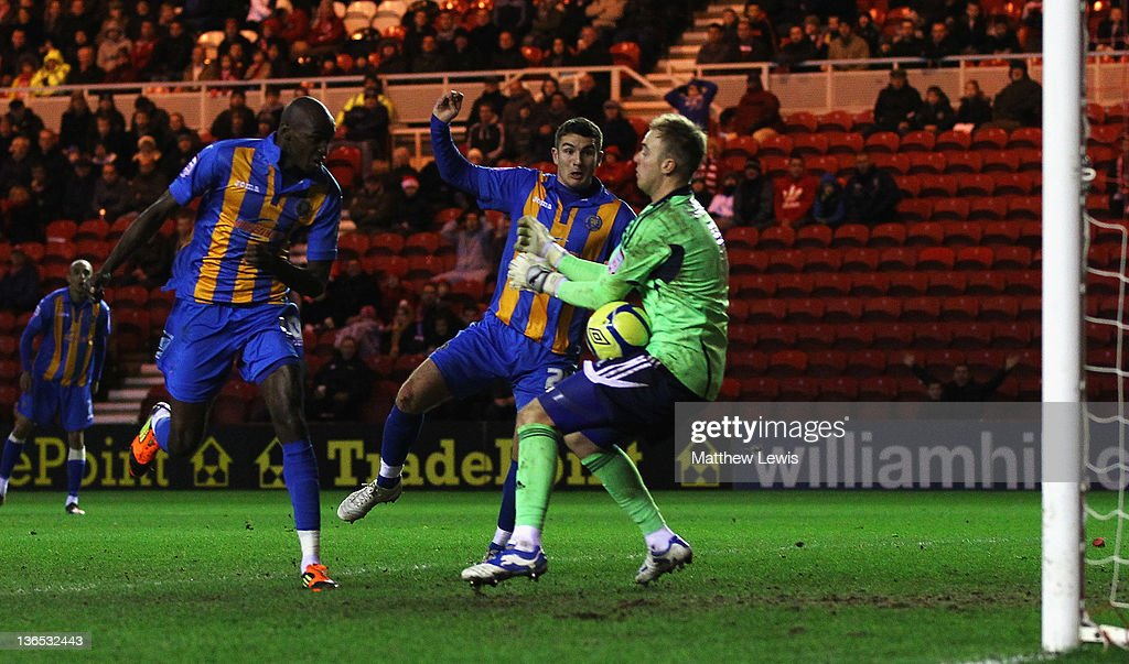 Jason Steele of Middlesbrough sabves a close range header from Marvin Morgan of Shrewsbury during the FA Cup Third Round match between Middlesbrough and Shrewsbury Town at Riverside Stadium on January 7, 2012 in Middlesbrough, England.