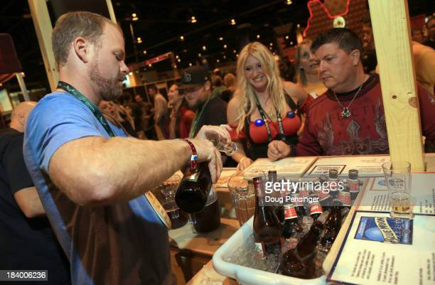 Jason Stillman of Blue Moon Brewing Company in Denver pours beers for Shawna Silber and Michael Bernard at the 32nd annual Great American Beer...