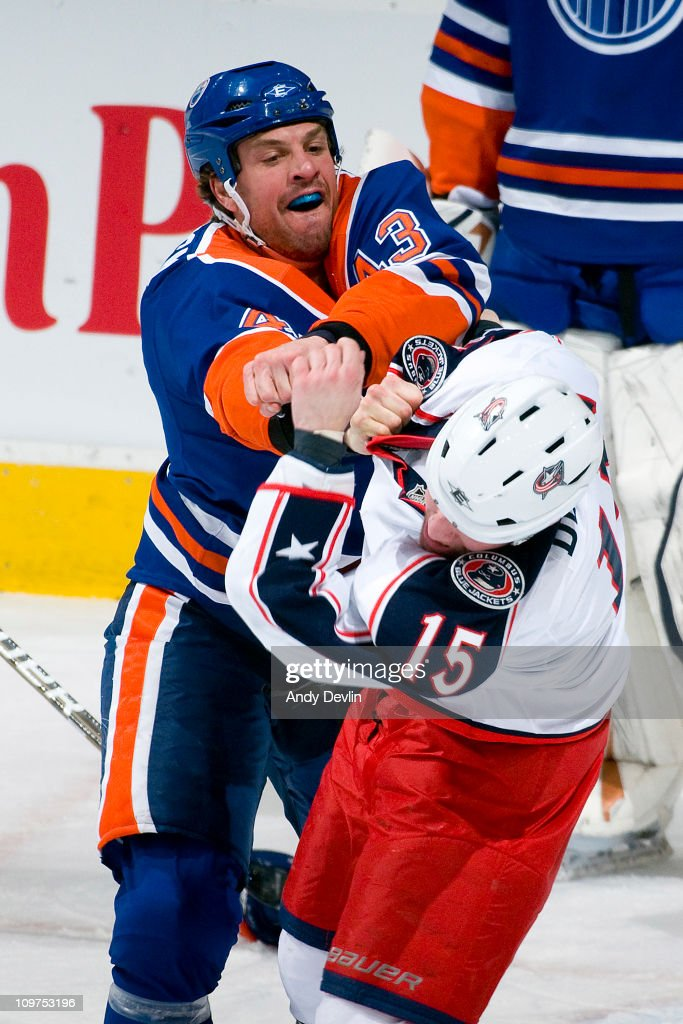 Jason Strudwick #43 of the Edmonton Oilers lands a hard punch on Derek Dorsett #15 of the Columbus Blue Jackets during a fight at Rexall Place on March 3, 2011 in Edmonton, Alberta, Canada.