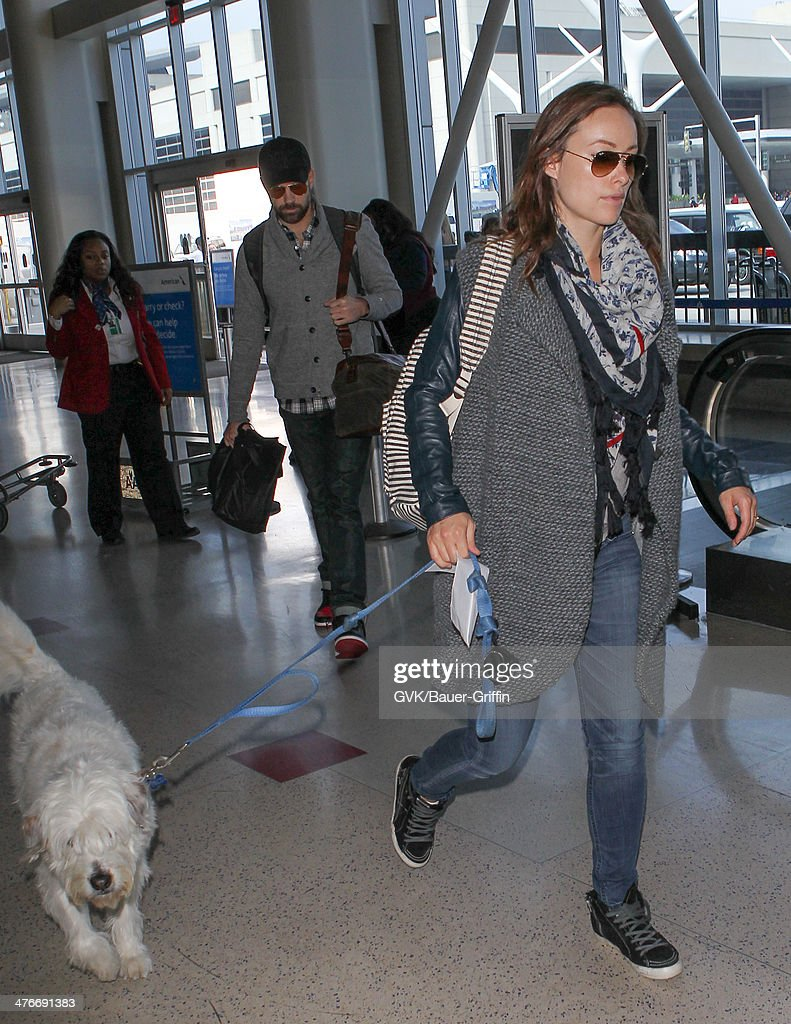 Jason Sudeikis and Olivia Wilde are seen at LAX airport on March 04, 2014 in Los Angeles, California.