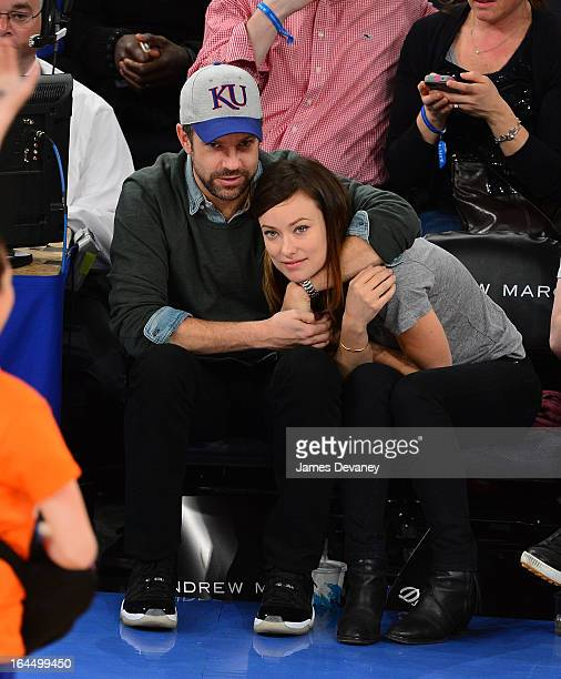 Jason Sudeikis and Olivia Wilde attend the Toronto Raptors vs New York Knicks game at Madison Square Garden on March 23 2013 in New York City